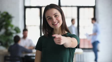 прокат : Happy confident young businesswoman professional hr manager employer outstretch hand looking pointing finger at camera choosing hiring you offer employment new job, business choice concept, portrait Стоковые видеозаписи