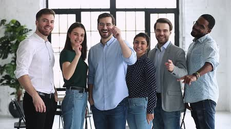 прокат : Happy confident professional multiethnic business team people company staff group point finger look at camera choose you to join corporate team stand in office together, recruiting and choice concept Стоковые видеозаписи