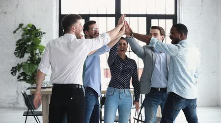 trabalho em equipe : Happy diverse professional business office team give high five together in office, multiethnic coworkers group celebrate corporate success engaged in unity teamwork partnership concept, slow motion Vídeos