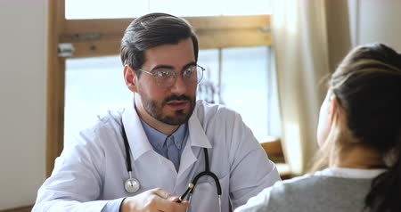 rada : Friendly professional male professional doctor plastic surgeon wear white uniform glasses talk consult woman patient at medical checkup consultation in clinic office, medicine and healthcare concept Wideo