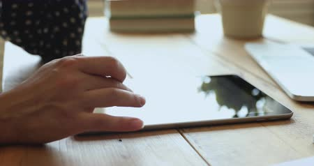 ebook : Woman student using digital tablet on table, female hands typing on touchscreen computer browsing searching online study e learning internet course at desk, distance education concept, close up view Stock Footage