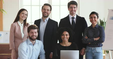 multirracial : Six smiling multiethnic business people executive group posing in modern corporate office with laptop computer, young diverse ethnicity professional managers staff looking at camera, team portrait