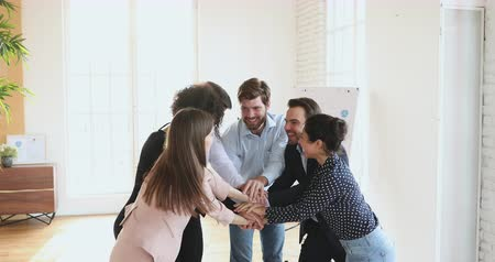 multikulturális : Successful united multicultural business team people stacking hands together express teamwork concept, friendly diverse designers workers group motivated for result celebrate teambuilding cooperation Stock mozgókép