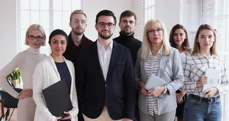 leden : Confident smiling successful multicultural team portrait, happy proud diverse ethnicity executives leaders group eight professional workforce people standing in corporate office looking at camera