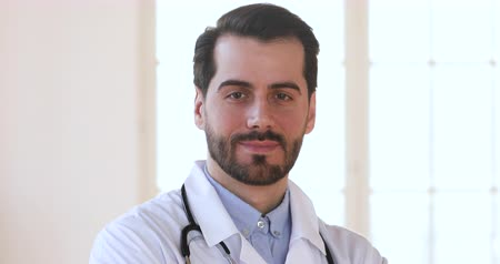lab employee : Smiling confident professional young male doctor wear white uniform stethoscope looking at camera, serious happy bearded 30s man successful medic physician gp surgeon posing for close up face portrait