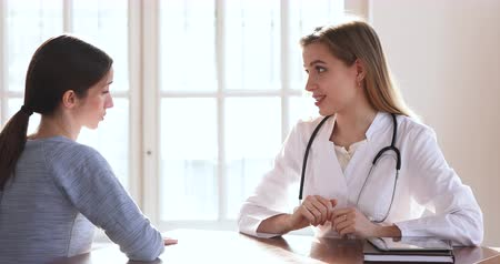 prescribe : Friendly young woman professional doctor gynecologist specialist wear medical uniform consulting ill sick female patient explain diagnosis treatment giving healthcare advice at medical checkup visit Stock Footage