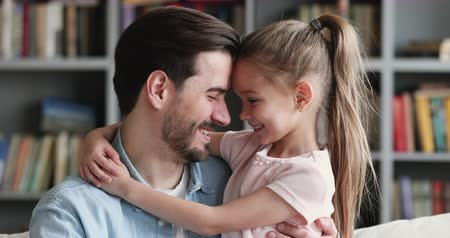 abraços : Happy affectionate family adult single parent dad and small cute kid daughter cuddling looking at camera, loving happy daddy hug preschool child girl bonding embracing at home on fathers day concept