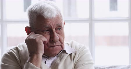 思考 : Sad thoughtful lonely senior 70s man sit alone at home look away think of solitude grief, upset depressed retired old adult grandfather feel pain anxiety suffer from loneliness concept, close up view