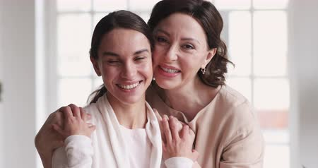 milující : Loving mature older mother hugging happy young adult grown daughter. Family laughing enjoying sincere positive emotions tenderness mothers love concept. Cheerful 2 two age generations women portrait Dostupné videozáznamy