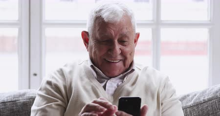 премия : Overjoyed senior old 80s man hold phone look at screen excited about mobile app sport bet bid win concept, happy elder grandfather winner celebrate victory success read good news in cell text message