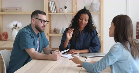 etnia africano : Confident young mixed race human resources managers recruiters holding job interview with female candidate. Skilled professional company workers discussing project details with client at office. Stock Footage