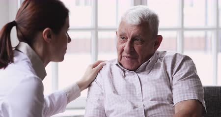 醫療保健 : Female doctor caregiver supporting senior grandpa male patient giving advice talking helping aged man during medical visit, elder care treatment, medicare responsibility older people healthcare concept