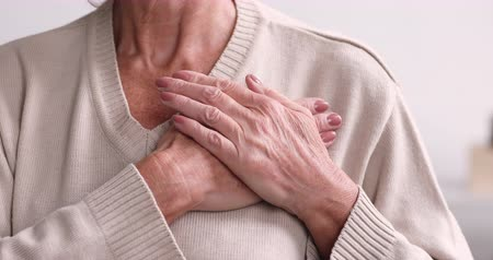 bizakodó : Grateful pleased senior elder woman holding hands on chest gesture feeling heartfelt gratitude concept. Hopeful thankful older grandma expressing honesty, trust and sincere appreciation. Close up view