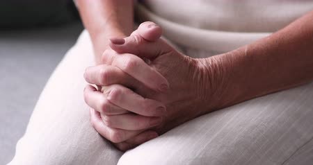 jesus christus : Close up view of senior female hands clasped. Retired lonely woman praying with hope feels anxiety and solitude. Older adult single grandmother pensioner worries about elder health care problem concept Videos