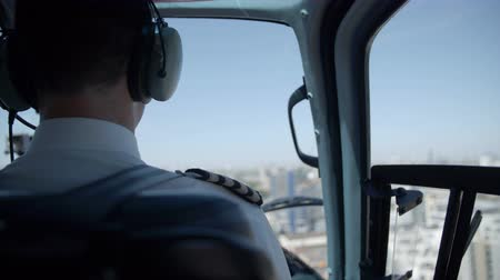 heliport : The back of pilot in a helicopter
