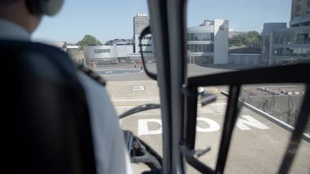 heliport : The back of pilot while preparing landing