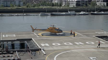 heliport : Helicopter landed on helipad Stock Footage