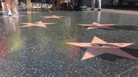 visitantes : LOS ANGELES - September 2016: Hollywood Walk of Fame with people walking by.