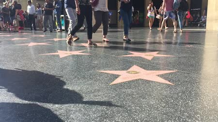 fama : LOS ANGELES - September 2016: Hollywood Walk of Fame with people walking by Stock Footage