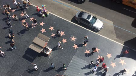 tiyatro : LOS ANGELES - September 2016: Hollywood Walk of Fame with people walking by.