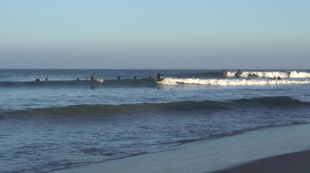 acrobata : Malibu, California, USA - September 2016: Surfing people ride on the waves