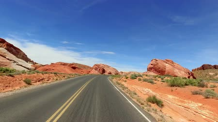 devletler : Incredibly beautiful landscape in Southern Nevada, Valley of Fire State Park USA. Smooth camera movement along the road.