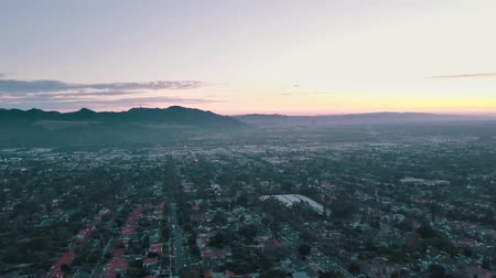 sinema : Cinema aerial panoramic video of the night city from a helicopter. Beautiful sunset in Los Angeles, California, USA