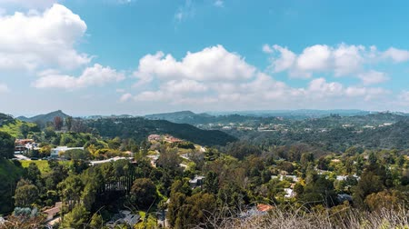 Beautiful TimeLaps Cinema shot 4K. View from the top of the Beverly Hills. Beautiful clouds move through the hills. A bright sunny day in Beverly Hills, Los Angeles, California