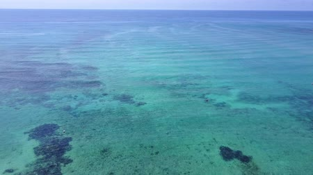 tyrkysový : Aerial drone shot. Flight over the beautiful bay. A view of the coast from a birds eye view. The camera looks into the distance. Turquoise water of the Caribbean Sea. Riviera Maya Mexico.