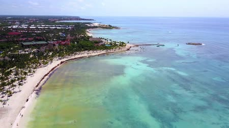 Aerial drone shot. Aerial view from above, birde eye view at an luxury resort hotel beach of a tropical coast. Turquoise water of the Caribbean Sea. Riviera Maya Mexico.
