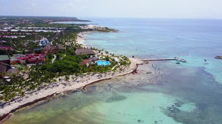 maya : Aerial drone shot. Aerial view from above, birde eye view at an luxury resort hotel beach of a tropical coast. Turquoise water of the Caribbean Sea. Riviera Maya Mexico.