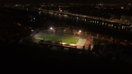 schoolyard : aerial view of football team practicing at night