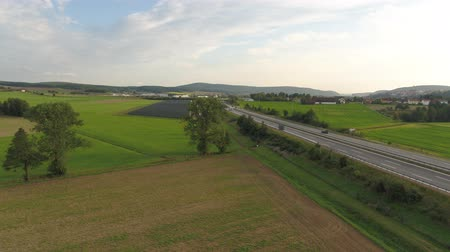 Drone Aerial of a road in countryside fields Europe Germany