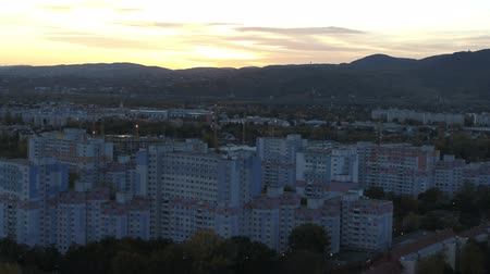visto : drone aerial vienna and alps at sunset. golden hour blue hour