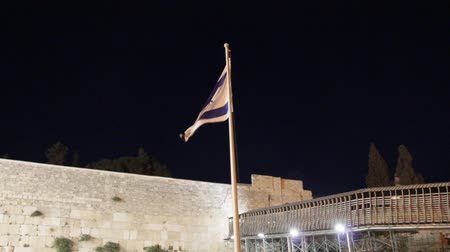 wailing : State flag of Israel at the night on Western Wall background