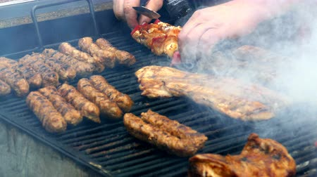 mici : Romanian sausages mici, skewers, and pork prepared on the grill. 4K footage. Stock Footage