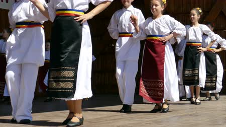 romanian traditional costume : TIMISOARA, ROMANIA - MAY 07, 2016: Children dancing a folk dance from Banat region, Romania.