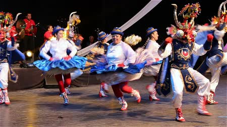 жить : ROMANIA, TIMISOARA - JULY 9, 2016: Chilean dancers in traditional costume, perform folk dance during International Festival of hearts organized by the City hall Timisoara.