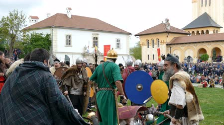 ALBA IULIA, ROMANIA - APRIL 30, 2017: Dacian and roman soldiers in battle costume, making a demonstration of fighting at APULUM ROMAN FESTIVAL, organized by the City Hall. 4K footage.