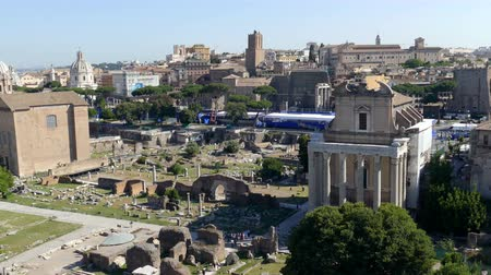 palatine : ROME, ITALY - MAY 31, 2017: Panoramic view over the ruins of the Roman Forum with the cityscape of Rome, Italy. 4K footage.