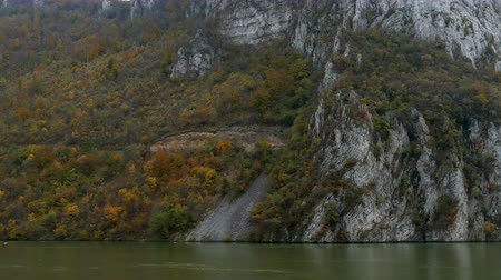 Autumn at the Danube Gorges, the border between Romania and Serbia. View from Romanian part. In the background is strait named Large Boilers. 4K footage.
