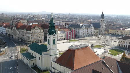 ORADEA, ROMANIA - JANUARY 27, 2018: Aerial view from the city hall tower over Oradea town with historic buildings, Crisul Repede and churches.