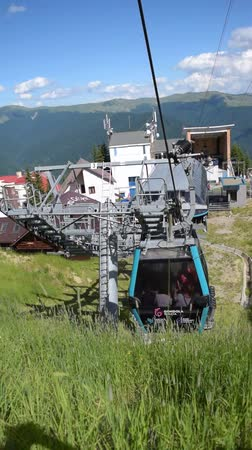 cabins : Sinaia, Prahova, Romania - June 29, 2019: View of the cable car gondola base station in Sinaia at 1400m altitude