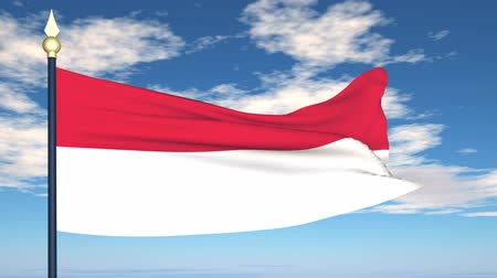 indonesia : Flag Of Indonesia on the background of the sky and flying clouds.