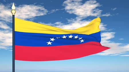 Flag Of Venezuela on the background of the sky and flying clouds.