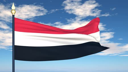 yemen : Flag Of Yemen on the background of the sky and flying clouds.