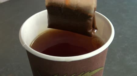 teabag : A tea bag in hot water