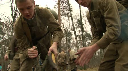 clearing the table : The partisans in the forest camp Stock Footage