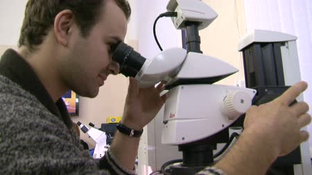 naukowiec : A scientist at the microscope