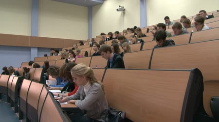 wykład : Students at a lecture in the classroom.